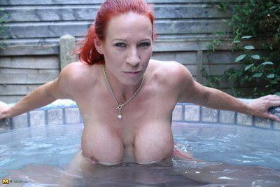 Big breasted british milf playing in th hottub