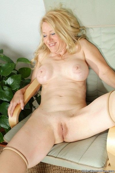 Senior lady robin strips off her clothes