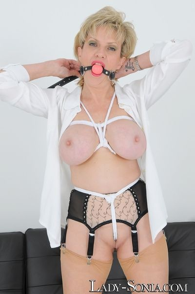 Lady Sonia dressed up in her rope bra crotch rope and ball gag