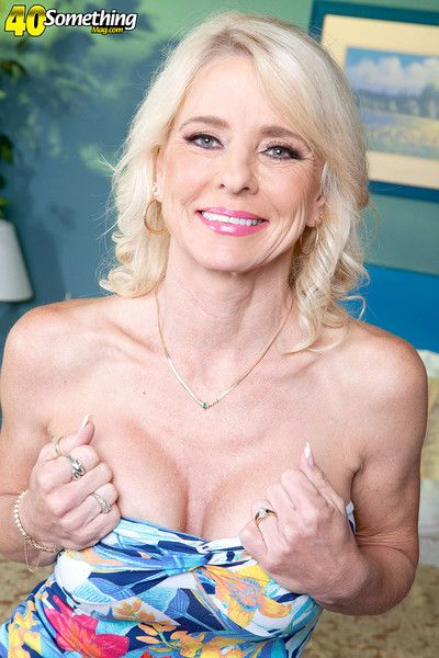 Busty mature pierced and slutty ready for cock