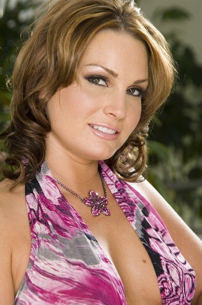 The kinky brunette milf Flower Tucci in flowered dress performed the horny softcore posing