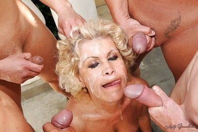 Filthy granny with big round jugs gets blowbanged and bukkaked outdoor
