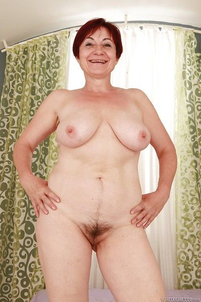 Lusty granny with big flabby tits stripping and spreading her legs
