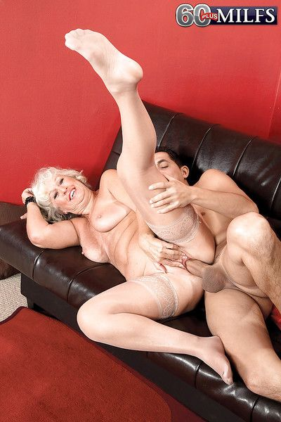 Horny granny Jeannie Lou getting fucked by younger man on futon
