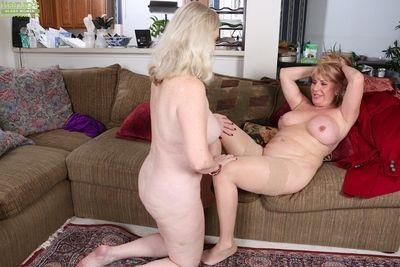Granny lesbians Judy Belkins and Rae Hart spread bald twats for cunnilingus