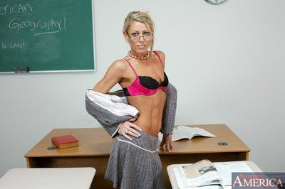 Mature teacher Chelsea Zinn showing off tiny tits and comely ass