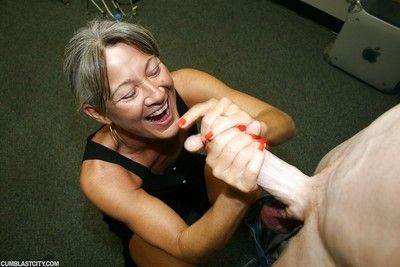 Fully clothed horny granny gives hot handjob and gets cum on face