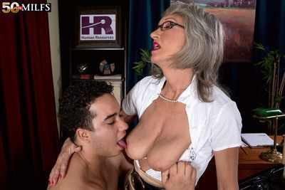 The horny boss lady and the cleaning man