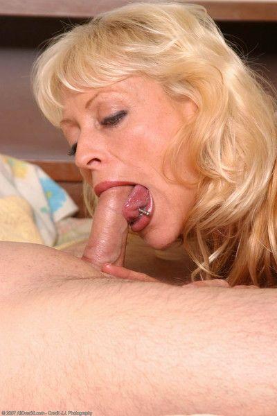 Mature blonde sucks cock