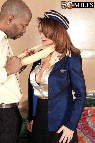 Mature flight attendant deauxma fucks with black passenger