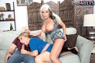 Two 60 milfs sharing huge stiff dick