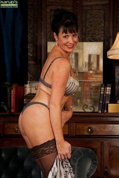 Older babe Elise Summers wearing only black stockings.