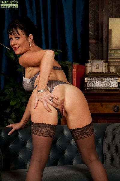 Older babe Elise Summers wearing only black stockings.