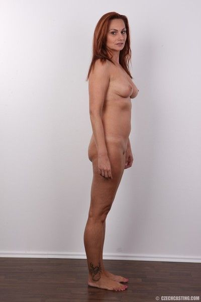 Hot mature redhead poses