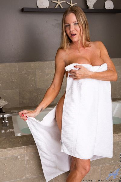 Amber michaels peels off her towel to show her gigantic tits and