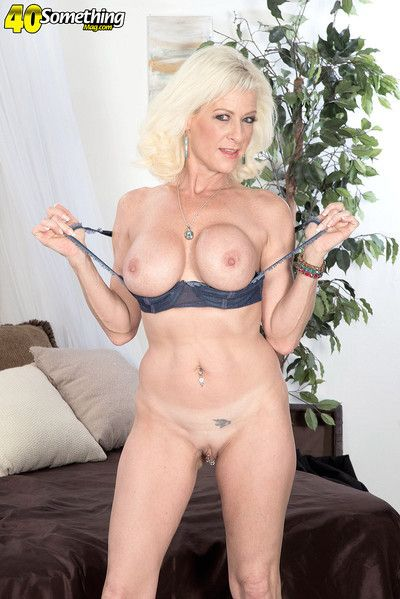 Mature gets her ass is filled with a fuck toy