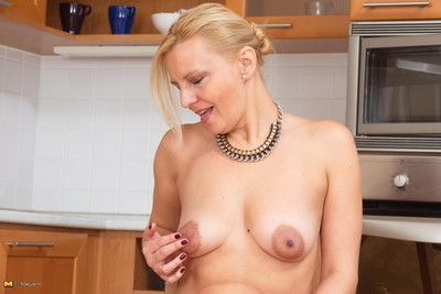 This housewife loves to get naughty in her kitchen