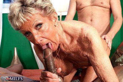 Dirty granny slut sandra ann doing two cocks at the same time