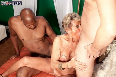 Dirty granny slut sandra ann doing two cocks at the same time