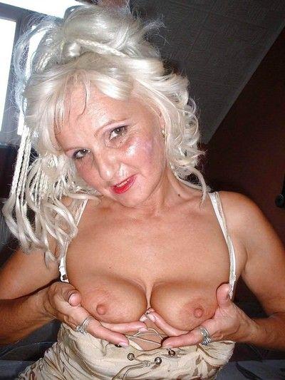 Lingerie granny spreading her wrinkled pussy
