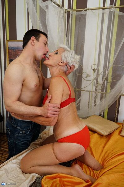 Horny mature woman playing with her toy boy