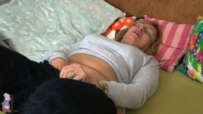 Fat and hairy old granny masturbating with a big dildo