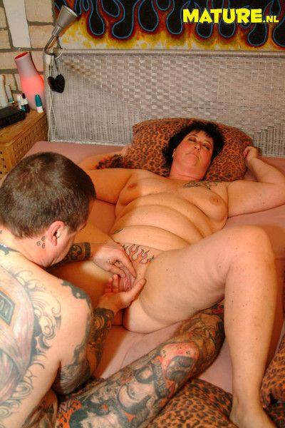 Mature tatooed couple having red hot firey sex