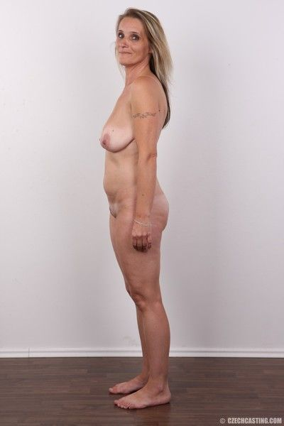 Mature wife poses for photo camera