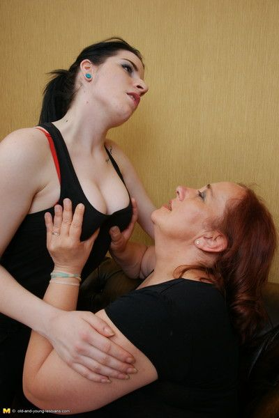 Old and young lesbian couple go at it