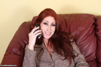 Redhead milf Tiffany giving a handjob as a tip