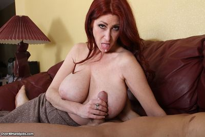 Redhead milf Tiffany giving a handjob as a tip