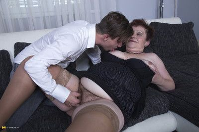 Naughty older lady doing her toy boy on the couch