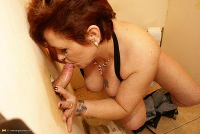 This kinky mature slut does two cocks at once