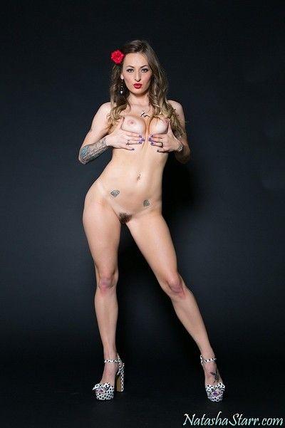 Tattooed pornstar Natasha Starr peeling off brassiere and granny panties