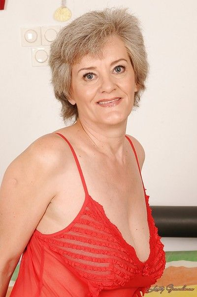 Naughty granny with big flabby boobs taking off her lingerie