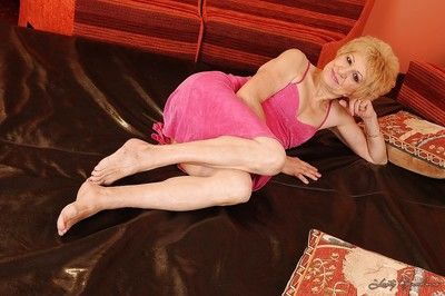 Filthy granny Kati Bell taking off her pink dress and spreading her legs