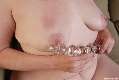 Granny Spicy penetrates her lovely pink pussy with this hardcore dildo