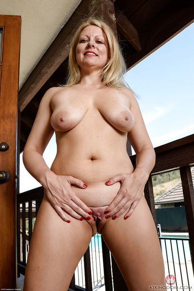 Mature blond woman Zoey Tyler fondling big hanging boobs for close ups