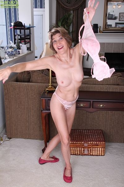 Experienced lady Bossy Ryder fingering her hairy granny twat