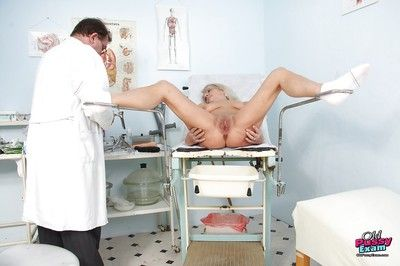 Chubby granny strips for the doc in a hairy cunt finger fucking