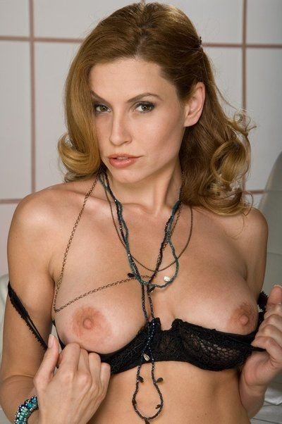 Bosomy milf Jamie Lynn plays with big melons and entertains with dildo toy