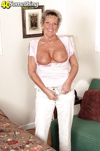 Busty granny Sandra Ann lustfully plays with her ass in tight lingerie