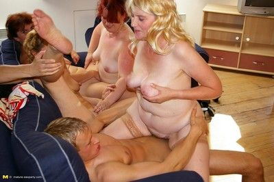 Horny mature sluts sharing one hard cock