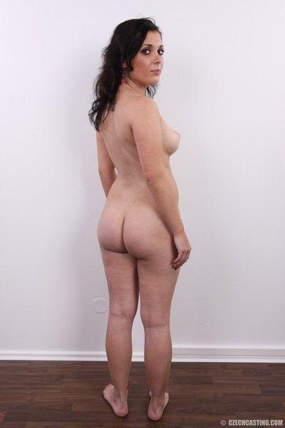 Mature brunette poses naked