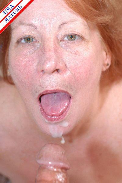 Mature redhead sucking a hard throbbing cock