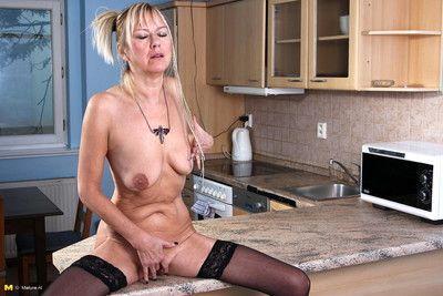 Kinky minx playing with her saggies