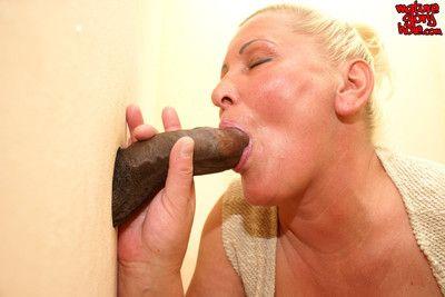 Granny fucking and sucking behind the gloryhole