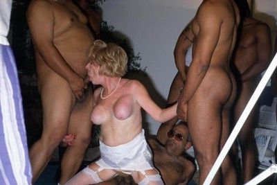 Old grandma getting banged by black dudes