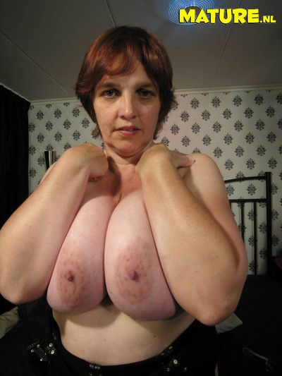 This big titted mama is proud of her natural bazooms