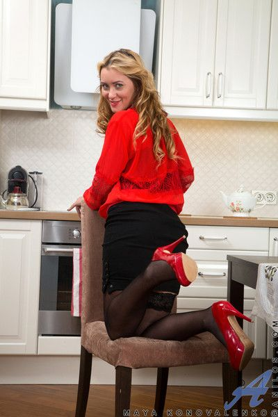 Seductive blonde mommy gets down and dirty in the kitchen teasin